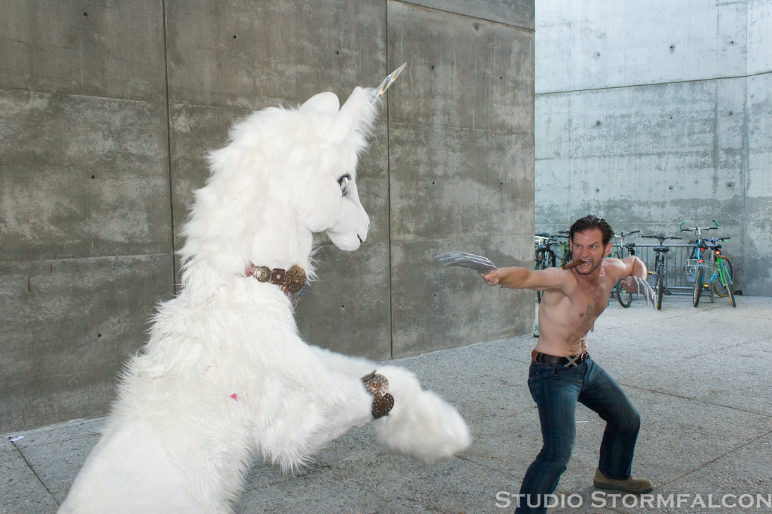 wolverine vs the unicorn by stormfalcon